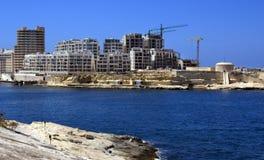 Hotel under construction. Modern hotel under construction on Valletta harbor waterfront, Malta stock photography