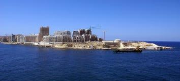 Hotel under construction. Modern tourist hotel under construction on coastline of Valletta city, Malta royalty free stock photos
