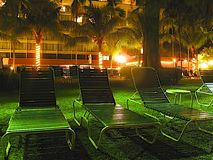 Hotel view - Sun lounges  at night Royalty Free Stock Photos
