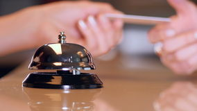Hotel visitor ringing vintage bell at the Reception. stock video footage