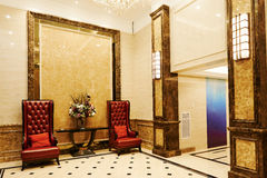 Hotel waiting hall. Waiting hall in a luxury hotel ,with  leather armchairs , luxurious wall and floor decoration Stock Image
