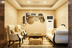 Hotel waiting hall. Waiting room in a luxury hotel ,with leather armchairs ,leather sofa, luxurious decoration.illuminated by led light royalty free stock photo