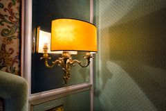Hotel wall lamp light. Night, mirror and shadow royalty free stock images