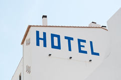 Hotel on wall of white building Royalty Free Stock Photos