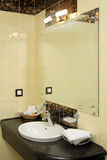 Hotel washroom. With sink and towels Stock Photo