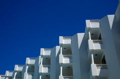 Hotel white balconies view against the blue sky stock photo