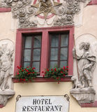 Hotel Window. Hotel Window with statues. Captured in Prague, Czech Republic Royalty Free Stock Image