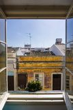 Hotel window Faro Portugal street view with plant in window stock photography