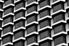 Hotel windows black & white. Hotel windows showing curtains through large glass windows, in black and white Royalty Free Stock Photos
