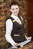 Hotel worker with key card Stock Image