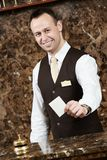 Hotel worker with key card Stock Photo