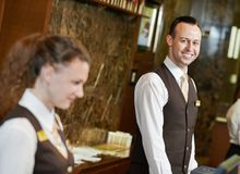 Hotel worker on reception Royalty Free Stock Image