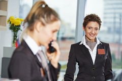 Hotel workers on reception Royalty Free Stock Photo