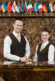 Hotel workers on reception Stock Photos