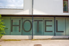 Hotel written in letters on a window Stock Images