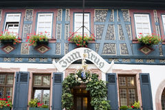 Hotel Zum Krug, Eltville, Germany. Painted half-timber Hotel Zum Krug in Eltville on River Rhine in Germany Royalty Free Stock Image