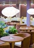 hotellrestaurangtabeller Royaltyfri Bild