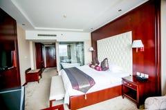 Hotelowy łóżko Zdjęcia Stock