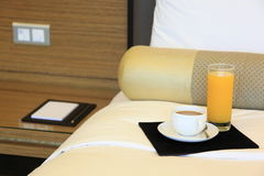 Hotelroom. Bed with coffee and jucie Royalty Free Stock Image