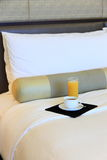 Hotelroom. Bed with coffee and jucie royalty free stock photography