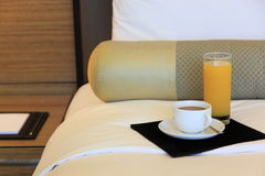 Hotelroom. Bed with coffee and jucie stock image