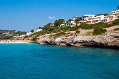 Hotels and the beach - view at Cala Romantica Royalty Free Stock Photos