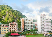 Hotels in Catba. Hotels in Cat Ba island with limestone mountains in the background Royalty Free Stock Photo