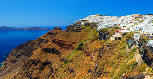 Hotels of Fira town on the slopes of volcanic mountain overlooking the sea and Caldera of Santorini, Greece. royalty free stock photo