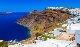 Hotels of Fira town on slopes of volcanic mountain overlooking sea and Caldera of Santorini, Greece. royalty free stock photo