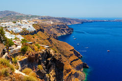 Hotels of Fira town on slopes of volcanic mountain overlooking the sea and Caldera of Santorini, Greece. stock photo