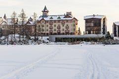 Hotels on the frozen lake Strbske pleso in the High Tatras. Royalty Free Stock Photo