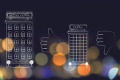 Hotels next to thumbs up and thumbs down Royalty Free Stock Image