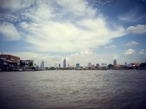 Hotels by the river view from a boat in Thailand stock photo