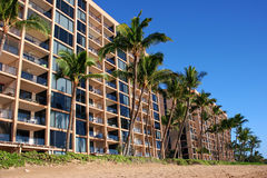 Hotels on tropical beach. Scenic view of hotels on tropical beach with palm trees in foreground, Maui Island, Hawaii, U.S.A Stock Images