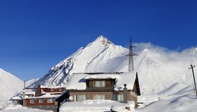 Hotels in winter snowy mountains at sun day Royalty Free Stock Images