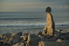Driftwood and rock sculpture in Hokitika stock photography