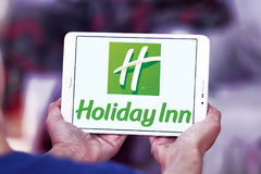 Hotliday Inn hotels logo. Logo of Holiday Inn hotels on samsung tablet. Holiday Inn is an American brand of hotels, and a subsidiary InterContinental Hotels royalty free stock images