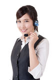 Hotline. Closeup portrait of Asian business woman on studio white background Stock Photo