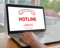 Hotline concept on a laptop. Man using a laptop with hotline concept on the screen Stock Photo