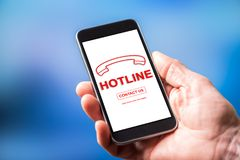 Hotline concept on a smartphone. Smartphone screen displaying a hotline concept Stock Image