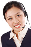Hotline operator. A friendly hotline operator with headsetoperator isolated on a white background Stock Photography