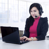 Hotline operator smiling on the camera Stock Photography