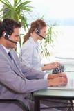 Hotlinesangestellte bei der Arbeit Lizenzfreie Stockfotografie