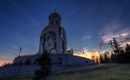 Hoto of the church against the setting sun Stock Photos