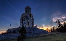 Hoto della chiesa contro il tramonto Fotografie Stock