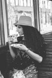 Hoto of girl in a wagon train drinking coffee or tea while looki Royalty Free Stock Images
