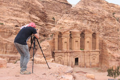 Hotographer taking a picture of an ancient temple in Petra, Jordan Stock Images