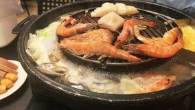 Hotpot de BBQ de barbecue de fruits de mer de porc de boeuf de Mookata banque de vidéos