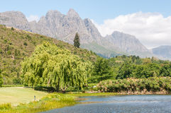 Hottentots-Holland Mountains towering above a dam Royalty Free Stock Photos