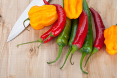 Hottest peppers on a table. Stock Photo